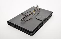 眼镜电子书 免版税库存图片