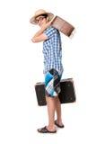戴眼镜的一个年轻,可爱的快乐人和准备好两个的手提箱 库存照片
