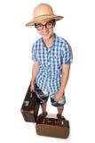 戴眼镜的一个年轻,可爱的快乐人和准备好两个的手提箱 图库摄影