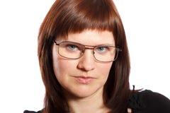 戴眼镜的严肃的妇女 库存照片