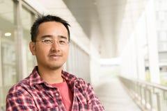 戴眼镜的亚裔人 库存照片
