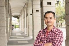 戴眼镜的亚裔人 免版税图库摄影