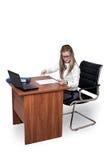 戴眼镜的女孩在您的书桌 图库摄影