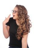 戴眼镜的少妇在白色打呵欠 免版税库存图片