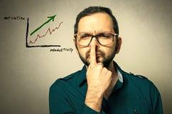 戴眼镜的怪杰有一个想法 免版税图库摄影