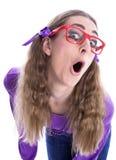 戴眼镜的淘气女孩 免版税图库摄影