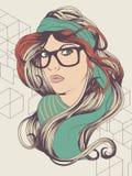 戴眼镜的行家女孩 免版税图库摄影