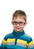 戴眼镜的逗人喜爱的孩子 免版税库存图片