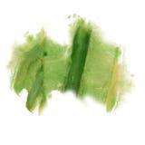 着墨在白色背景隔绝的泼溅物水彩绿色染料液体水彩宏观斑点污点纹理 免版税库存照片