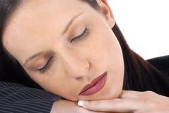 睡着女性的女实业家休息或,放置在手 免版税库存图片