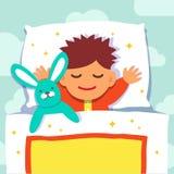 睡觉与他的兔子玩具的男婴 图库摄影