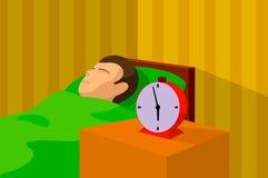 睡觉在与一个闹钟的床上的一个人的动画片图象在他旁边 图库摄影