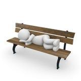 睡觉在公园长椅 库存照片