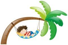 睡觉在吊床的小男孩 免版税库存照片