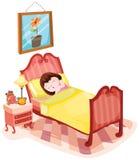 睡觉在床上的逗人喜爱的女孩 免版税库存图片