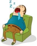 睡觉在沙发 免版税库存照片