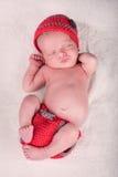 睡觉在他的新出生的婴孩  免版税库存照片