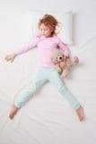 睡觉在Freefaller的小女孩顶视图 库存照片
