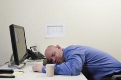 睡觉的商人 库存图片