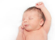 睡觉的新出生的男婴 库存照片