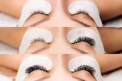 睫毛引伸做法 与长的睫毛的妇女眼睛 关闭,选择聚焦 免版税库存照片