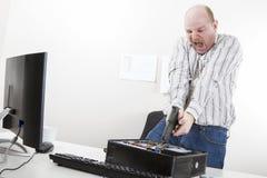 瞄准在CPU的商人枪书桌 图库摄影
