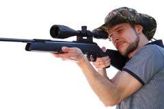 瞄准望远镜步枪的聪明的射击者 免版税库存图片