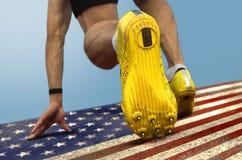 短跑选手起动美国旗子 图库摄影