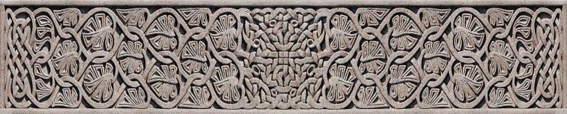 石凯尔特结-在凯尔特十字架的细节 免版税库存照片
