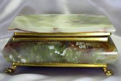 从石华的小箱在金框架 库存图片