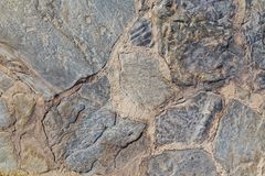 石古色古香的石工背景和纹理在路的 库存图片