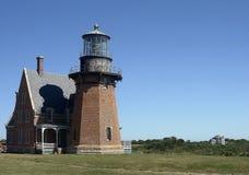 石块海岛灯塔 免版税库存照片