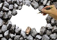 石墙和空间在中心用手和铅笔 免版税库存图片