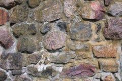 石墙外部,与纹理的背景 免版税库存图片