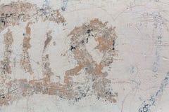 石墙纹理有削皮油漆的 摘要 库存图片