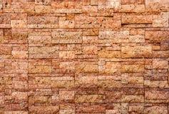 石墙纹理照片人为古色古香的背景  免版税库存图片