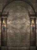 石头火炬点燃墙壁 免版税库存图片