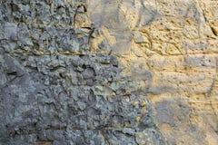 石头老墙壁的纹理  免版税库存照片