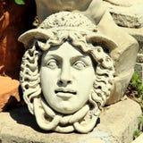 石头被雕刻的水母头 库存照片