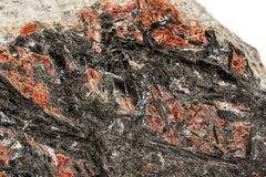石头辉锑矿的宏指令矿物在白色背景 免版税库存照片