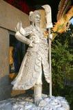 石寺庙监护人在合艾,泰国城市公园  免版税图库摄影