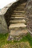 石弯曲的楼梯 库存图片