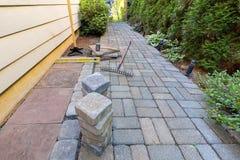 石摊铺机和工具为旁院环境美化 免版税库存照片