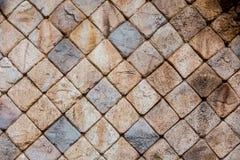 石方形的砖块墙壁纹理背景 免版税库存图片