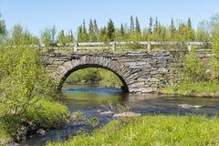 石曲拱桥梁Jamtland 图库摄影