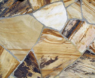 石板岩被仿造的墙壁部分 库存照片