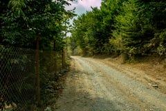 石渣向农场的土地路 库存照片