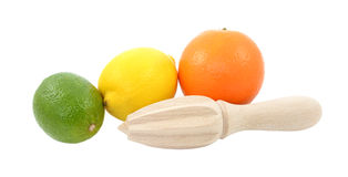 石灰、柠檬和橙色果子与木柑橘绞刀 库存图片