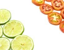 石灰和蕃茄切片 免版税库存照片