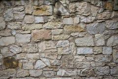 石老墙壁纹理 在老中世纪砖的岩石块 免版税库存图片
